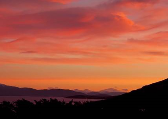 Photograph 'Looking right' from the house in Skye: Sunrise over the mainland